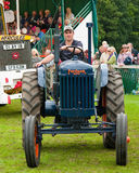 Man driving old Tractor Stock Images