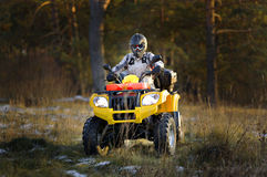 Man driving quad bike stock photography