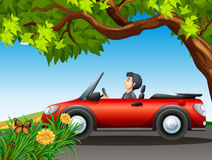 A man driving a red car Royalty Free Stock Images