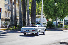 Man driving a retro car  on the street in Cannes ,France Royalty Free Stock Photo