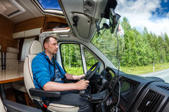Man driving on a road in the Camper Van Stock Image