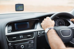 Man driving with satellite navigation system. In his car stock photography