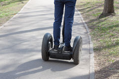 Man driving on segway. In summer day Royalty Free Stock Photos
