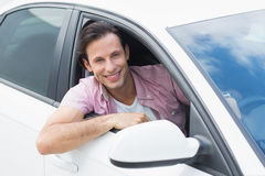 Man driving and smiling Royalty Free Stock Photo