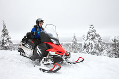 Man driving snowmobile in Finland stock images