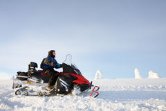 Man driving snowmobile in Finland. Man driving snowmobile in snowyfield in a sunny day. Lapland, Finland Stock Photos