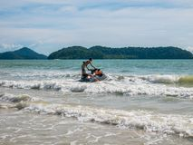 A Man Driving a Speedboat in the Beach. A Man Driving a Speedboat in Cenang Beach Langkawi Malaysia: October 25 2017 stock photos