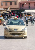 Man driving taxi. In a shopping street of Marrakesh in Morocco, is an editorial vertical image on a sunny day Royalty Free Stock Images