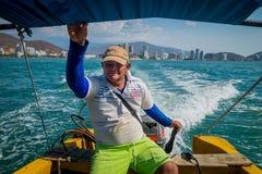 Man driving touristic boat in Playa Blanca, Santa Stock Photography