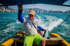 Man driving touristic boat in Playa Blanca, Santa Stock Images