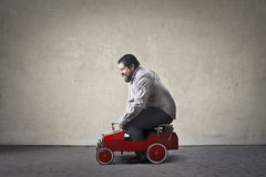 Man driving. A toy car royalty free stock image