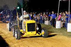 Man Driving Tractor at Pulling Competition Stock Image
