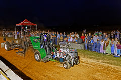 Man Driving Tractor at Pulling Competition Royalty Free Stock Photography
