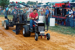 Man Driving Tractor at Pulling Competition Royalty Free Stock Image