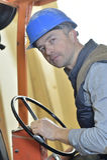 Man driving warehouse trolley Royalty Free Stock Photo
