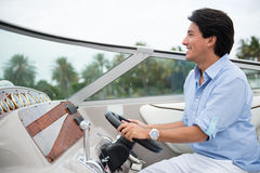 Man driving a yacht Stock Photography