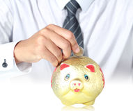 Man is drops piggy bank Royalty Free Stock Images
