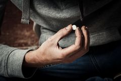 A man is a drug addict using drugs. The concept of anti drugs.  Royalty Free Stock Photo