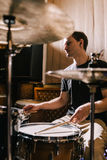 Man drummer playing drums in recording studio Stock Photo