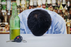 Man drunk in the bar Stock Photography