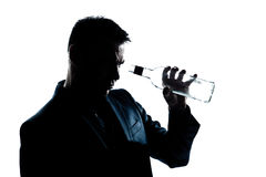 Man drunk looking at an empty alcohol botlle royalty free stock photos