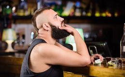 Man drunk sit alone in pub. Alcoholism and depression. Alcohol addicted concept. Hipster brutal man drinking alcohol. Ordering more drinks at bar counter. Guy royalty free stock images