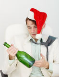 Man drunkard celebrates new year with wine bottle Stock Photos