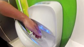Man dry hands on modern hand dryer Royalty Free Stock Photos