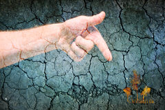 Man dry skin hand pointing on colourful trees on cracked grey background. Drought symbol Stock Photography