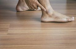 Man dry skin or pigmentation on foot with anklebone,Close up,Skin health Royalty Free Stock Images