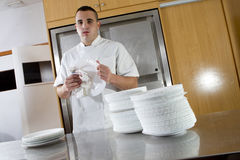 Man drying dishes Stock Photo
