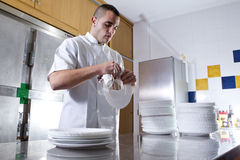 Man drying dishes Royalty Free Stock Image