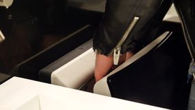 Man drying hands with air drier in public toilet. Young man drying his hands with air drier in public toilet or restroom stock video
