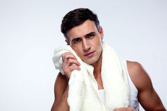 Man drying his face with towel Stock Photo
