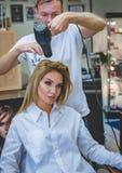Man Drying Woman's Hair Stock Image