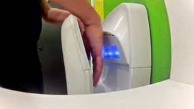 Man drys his hands on modern hand dryer Stock Photography