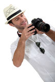 Man with DSLR camera Stock Photography