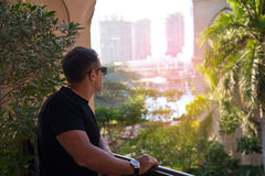 Man on the Dubai city looking at beautiful view. Royalty Free Stock Images