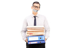 Man with duct taped mouth holding documents Royalty Free Stock Photography