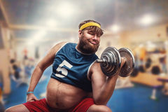 Man with a dumbbell Stock Photos