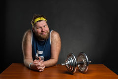 Man with a dumbbell Royalty Free Stock Image
