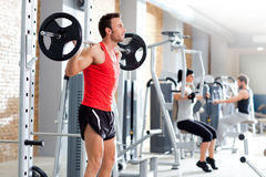 Man with dumbbell weight training equipment  gym Royalty Free Stock Photo
