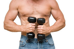 Man with dumbbells. Young man with black dumbbells Stock Photos