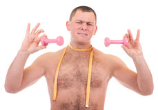 Man with dumbbells and measure Stock Image