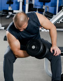 Man with dumbbells in sports club Stock Images