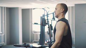 Man dumbbells workout in the gym stock video footage