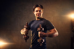 Man with dumbbells Stock Photo