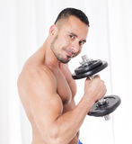 Man with dumbell Royalty Free Stock Photos