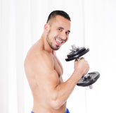 Man with dumbell Royalty Free Stock Photography