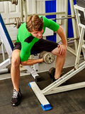 Man dumbell workout in gym. Muscle male working dumbbells body . Man dumbell workout in gym. Muscle male working with dumbbells his body at gym. Top view of Royalty Free Stock Image